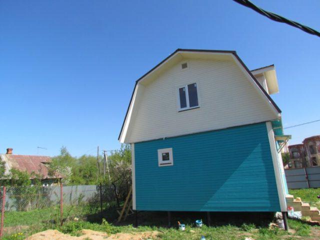 Красим деревянный дом
