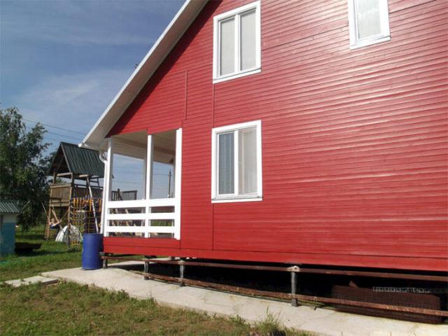 Покраска фасада деревянного дома краской Tikkurila